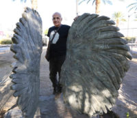 Bobby Jacobs and his sculpture Love and Courage